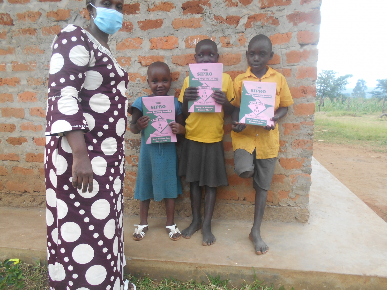 Jovia-and-friends-at-the-Family-Nursery-School-receive-study-materials